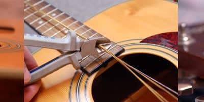Changement cordes – Entretien guitare folk